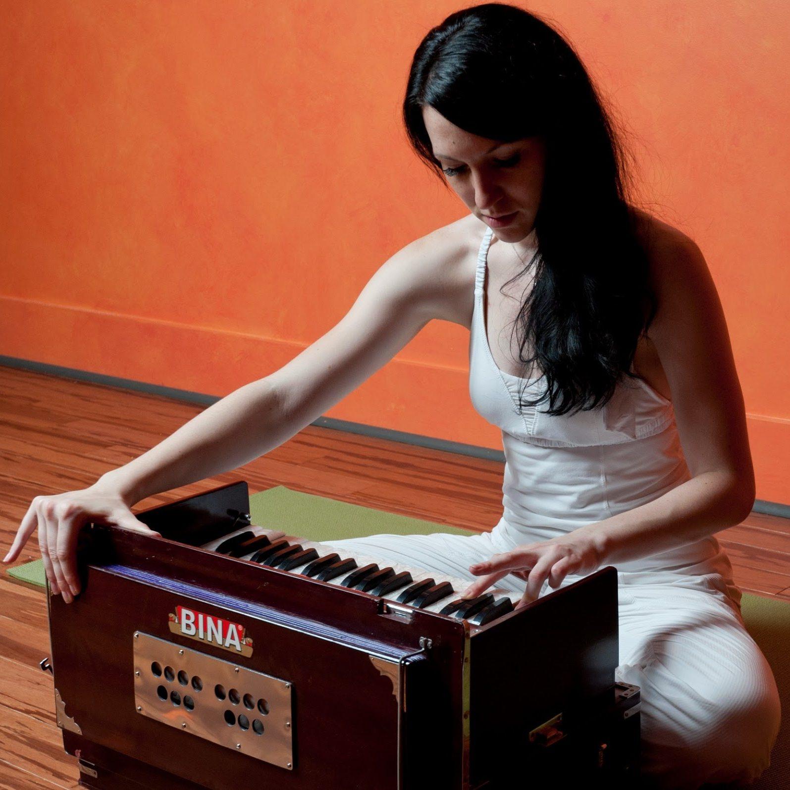 tai playing harmonium